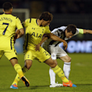 Partizan Belgrade's Sasa Ilic, right, is challenged by Tottenham Hotspur's Benjamin Stambouli, center, while Tottenham Hotspur's Aaron Lennon watches the action during the Europa League Group C soccer match between Partizan Belgrade and Tottenham Hotspur