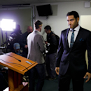 Philadelphia Eagles quarterback Mark Sanchez arrives for a news conference at the NFL football team's training facility, Friday, March 28, 2014, in Philadelphia. Sanchez agreed to a one-year contract with the Eagles after the New York Jets signed Michael
