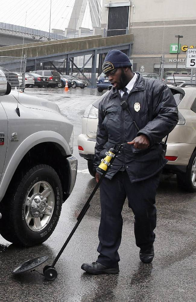 Security guards check vehicles entering the garage under TD Garden before Game 5 of the first round Stanley Cup Playoffs NHL hockey game between the Boston Bruins and Detroit Red Wings in Boston, Saturday, April 26, 2014