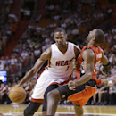 Miami Heat center Chris Bosh (1) is fouled by Toronto Raptors forward Patrick Patterson as he goes up for a shot during the first half of an NBA basketball game, Monday, March 31, 2014 in Miami The Associated Press