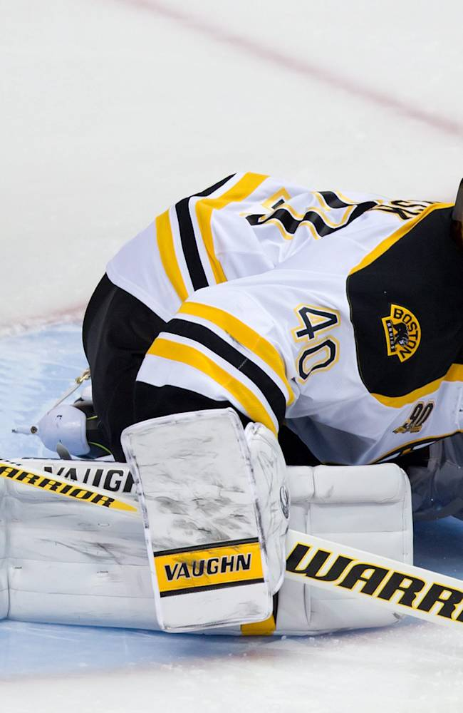 Boston Bruins' goalie Tuukka Rask, of Finland, allows a goal to Vancouver Canucks' Yannick Weber, of Switzerland, during third period NHL hockey action in Vancouver, British Columbia, on Saturday, Dec. 14, 2013