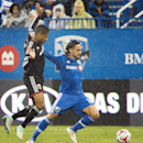 Montreal Impact's Issey Nakajima-Farran, right, and D.C. United's Sean Franklin battle for the ball during an MLS soccer game action in Montreal, Saturday, Oct. 25, 2014 The Associated Press
