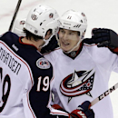 Columbus Blue Jackets' Matt Calvert (11) celebrates his goal with Ryan Johansen (19) in the third period of an NHL hockey game against the Pittsburgh Penguins in Pittsburgh, Monday, Dec. 9, 2013. The Penguins won 2-1 The Associated Press