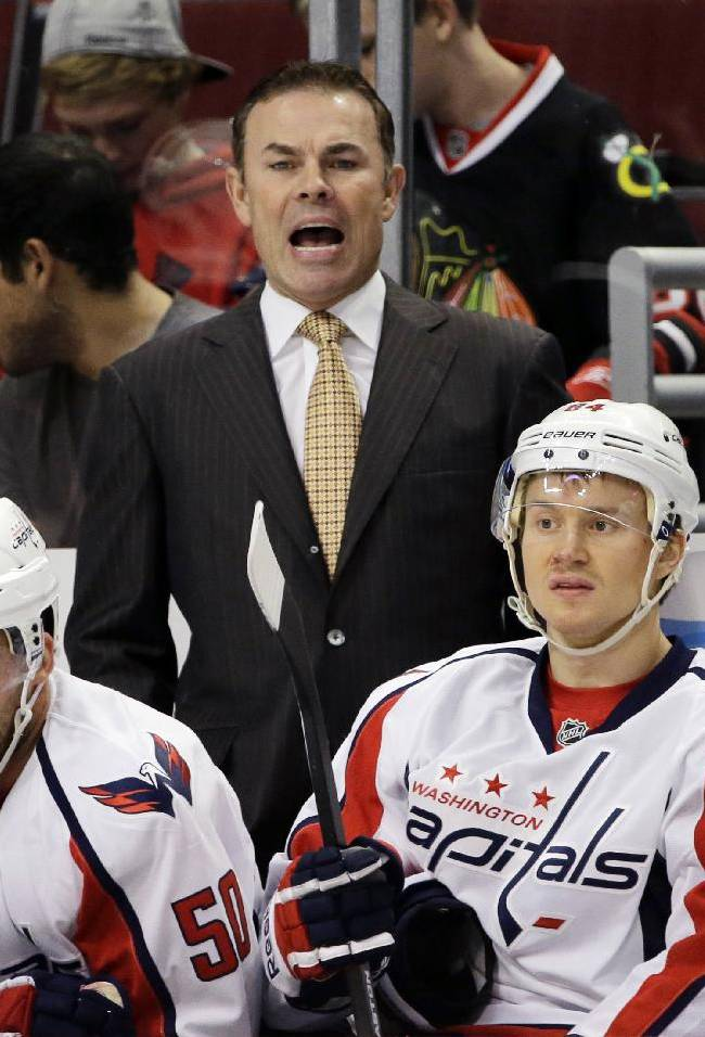 Washington Capitals head coach Adam Oates yells his team during the first period of an NHL preseason hockey game against the Chicago Blackhawks in Chicago, Saturday, Sept. 28, 2013