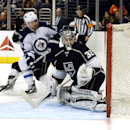 Winnipeg Jets right wing Blake Wheeler (26) scores a goal against Los Angeles Kings goalie Jonathan Quick (32) during the third period of an NHL hockey game Saturday, March 29, 2014, in Los Angeles The Associated Press