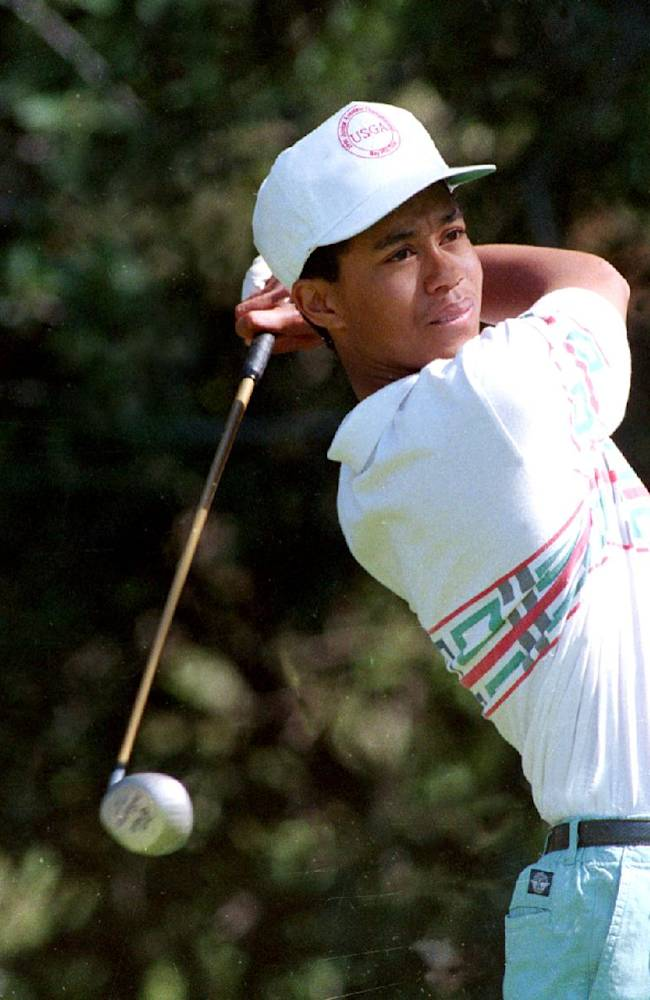 In this Feb. 26, 1992 file photo, amateur golfer Tiger Woods tees off at the 12th hole during the Pro-Am for the Los Angeles Open at Riviera Country Club in Los Angeles. Woods made his PGA Tour debut at Riviera when he was a 16-year-old junior in high school