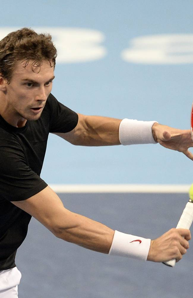 Switzerland's Henri Laaksonen returns a ball to Argentina's Juan Martin Del Potro during their first round match at the Swiss Indoors tennis tournament at the St. Jakobshalle in Basel, Switzerland, on Wednesday, Oct. 23, 2013