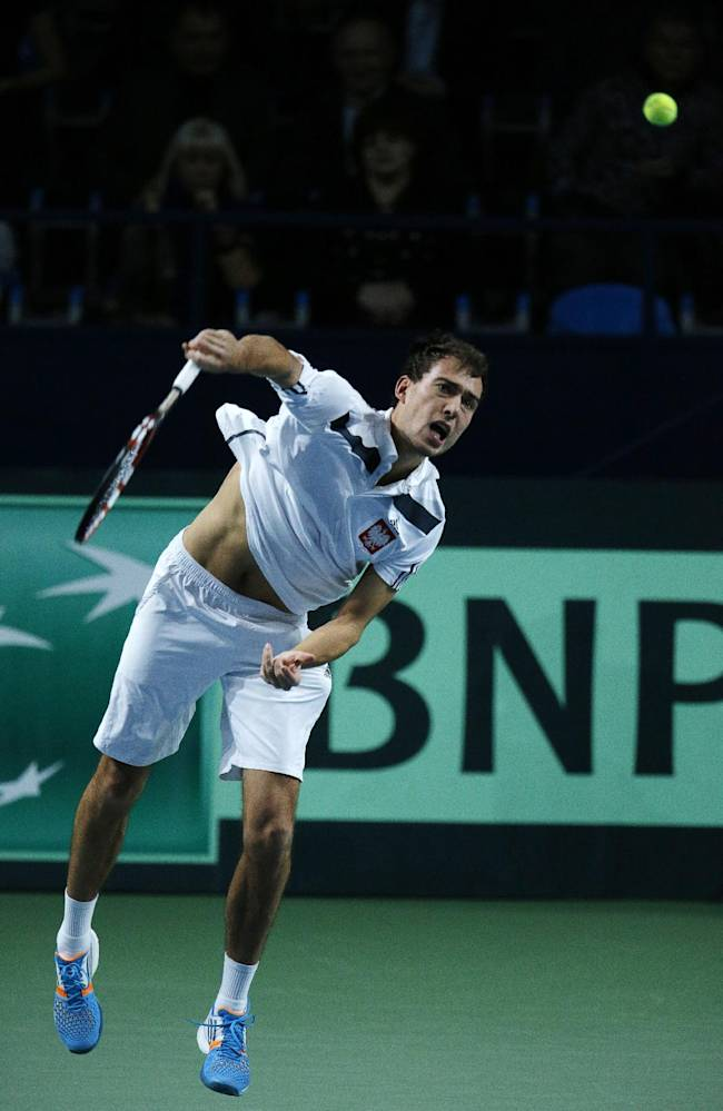 Poland's Jerzy Janowicz serves to Russia's Dmitry Tursunov during their Davis Cup First Group tennis match in Moscow, Russia, Sunday, Feb. 2, 2014