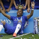 FILE - In this Sunday, May 24, 2015 file photo, the crown of the trophy is placed on the head of Didier Drogba after the English Premier League soccer match between Chelsea and Sunderland at Stamford Bridge stadium in London. Montreal Impact says it has s