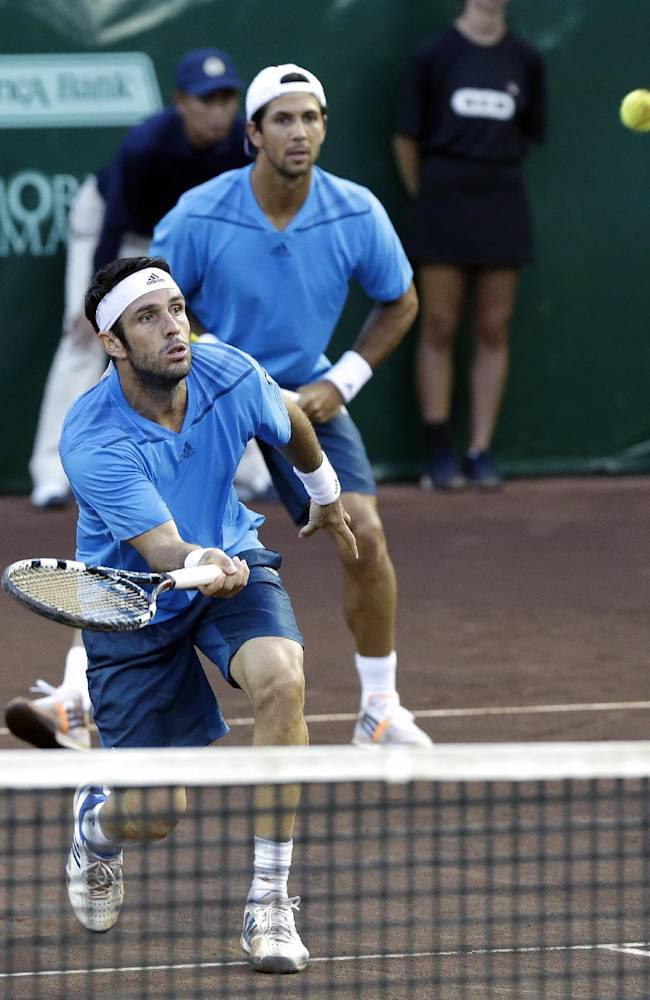 Spain's David Marrero, left, and Fernando Verdasco play the doubles final against Bob and Mike Bryan at the U.S. Men's Clay Court Championship tennis tournament Saturday, April 12, 2014, in Houston. The Bryan brothers won 4-6, 6-4, 11-9