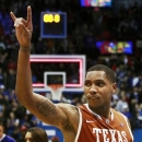 FILE - In this Jan. 22, 2011 file photo, Texas forward Gary Johnson (1) signals to fans following their 74-63 win over Kansas in an NCAA college basketball game against in Lawrence, Kan. The Israel Basketball Association says former Texas player Johnson has been put in a medically induced coma after being hospitalized with head injuries. IBA spokesman Hagai Segal says Johnson, who plays for Israeli team Hapoel Galil Elyon, is being treated for a fractured skull and doctors are checking for any other possible damage. Segal says Johnson's condition is not life threatening and he will be woken up Wednesday, Feb. 20, 2013. (AP Photo/Orlin Wagner, File)