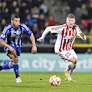 Kiev's Youns Belhande, left, and Aalborg's Nicolaj Thomsen during their Europa League Group J match between Aalborg Boldklub and Dynamo Kiev, in Aalborg, Denmark, Thursday, Oct. 23, 2014 The Associated Press