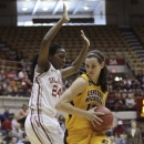Central Michigan's Jessica Schroll, right, drives to the basket against Oklahoma's Sharane Campbell during the first half of a first-round game in the women's NCAA college basketball tournament Saturday, March 23, 2013, in Columbus, Ohio. (AP Photo/Jay LaPrete)