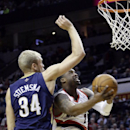 Portland Trail Blazers guard Wesley Matthews, right, drives to the basket against New Orleans Pelicans center Greg Stiemsma during the second half of an NBA basketball game in Portland, Ore., Sunday, April 6, 2014. Matthews scored 21 points as the Trail B