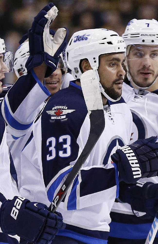 Winnipeg Jets' Dustin Byfuglien (33) celebrates his goal with teammates Mark Scheifele (55) and Keaton Ellerby (7) in the first period of an NHL hockey game against the Boston Bruins in Boston, Saturday, Jan. 4, 2014. The Bruins won 4-1