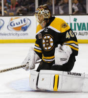 Boston Bruins goalie Tuukka Rask of Finland makes a save against the Phoenix Coyotes during the third period of Boston's 2-1 win in an NHL hockey game in Boston Thursday, March 13, 2014. (AP Photo/Winslow Townson)