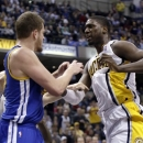 Indiana Pacers center Roy Hibbert, right, skirmishes with Golden State Warriors forward David Lee during the second half of an NBA basketball game in Indianapolis, Tuesday, Feb. 26, 2013. Lee received a technical foul; Hibbert received two technical fouls and was ejected from the game. The Pacers won 108-97. (AP Photo/AJ Mast)