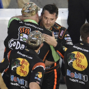 Sprint Cup Series driver Tony Stewart, right, is congratulated by a crew member for competitor Danica Patrick's Go Daddy team during qualifying for Sunday's NASCAR Sprint Cup Series auto race at Atlanta Motor Speedway, Friday, Aug. 29, 2014 in Hampton, Ga. (AP Photo/David Tulis)