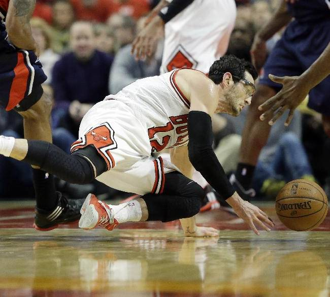 Chicago Bulls guard Kirk Hinrich (12) tries to control the ball during the first half of an NBA basketball game against the Atlanta Hawks in Chicago on Saturday, Jan. 4, 2014