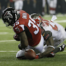 Atlanta Falcons running back Antone Smith (35) fumbles the ball as Tampa Bay Buccaneers cornerback Leonard Johnson (29) defends during the first half of an NFL football game, Thursday, Sept. 18, 2014, in Atlanta The Associated Press
