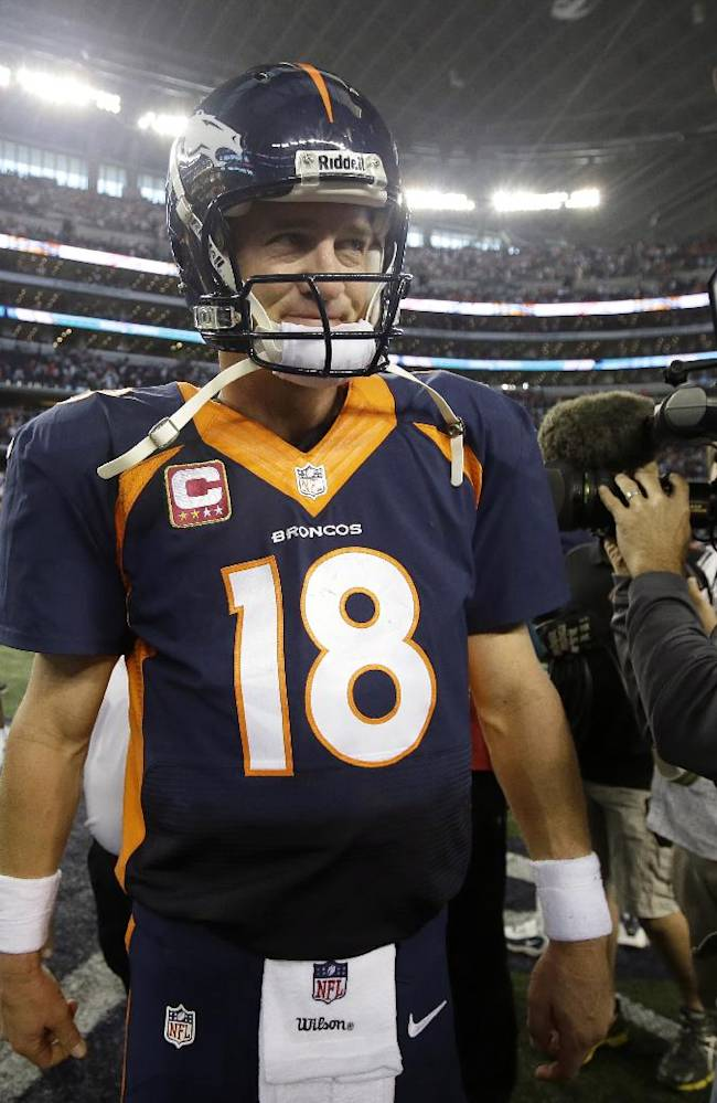 Denver Broncos' Peyton Manning walks off the field following an NFL football game against the Dallas Cowboys, Sunday, Oct. 6, 2013, in Arlington, Texas. The Broncos won 51-48
