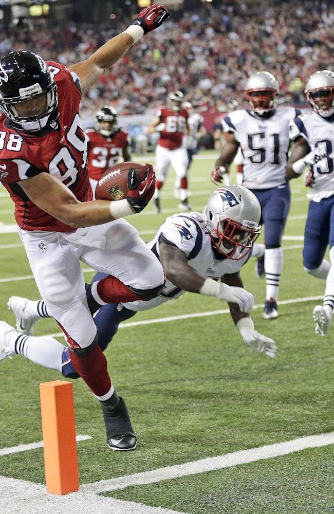 In this Sept. 29, 2013, file photo, Atlanta Falcons tight end Tony Gonzalez (88) runs into the end zone for a touchdown past New England Patriots cornerback Alfonzo Dennard (37) during the first half of an NFL football game in Atlanta.  The trade deadline has passed and Gonzalez knows where he'll be finishing his career. And unless the Falcons pull off an improbable turnaround, his 17th season will end like the previous 16, without a ring