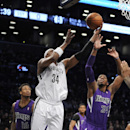 Brooklyn Nets' Paul Pierce (34) tries pull the ball away from Sacramento Kings' Jason Thompson (34) in the first half of an NBA basketball game on Sunday, March 9, 2014 at Barclays Center in New York. Pierce left the game with an injury The Associated Pre
