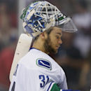 Vancouver Canucks goalie Eddie Lack, of Sweden, reacts after giving up goal to Colorado Avalanche left wing Gabriel Landeskog in the third period of the Avalanche's 7-3 victory in an NHL hockey game in Denver on Friday, Oct. 24, 2014 The Associated Press