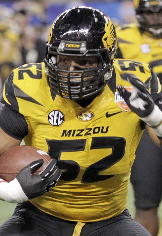 In this Jan. 3, 2014 file photo, Missouri defensive lineman Michael Sam (52) warms up before the Cotton Bowl NCAA college football game against Oklahoma State, in Arlington, Texas. Michael Sam hopes his ability is all that matters, not his sexual orientation.  Missouri's All-America defensive end came out to the entire country Sunday night, Feb. 9, 2014, and could become the first openly gay player in America's most popular sport