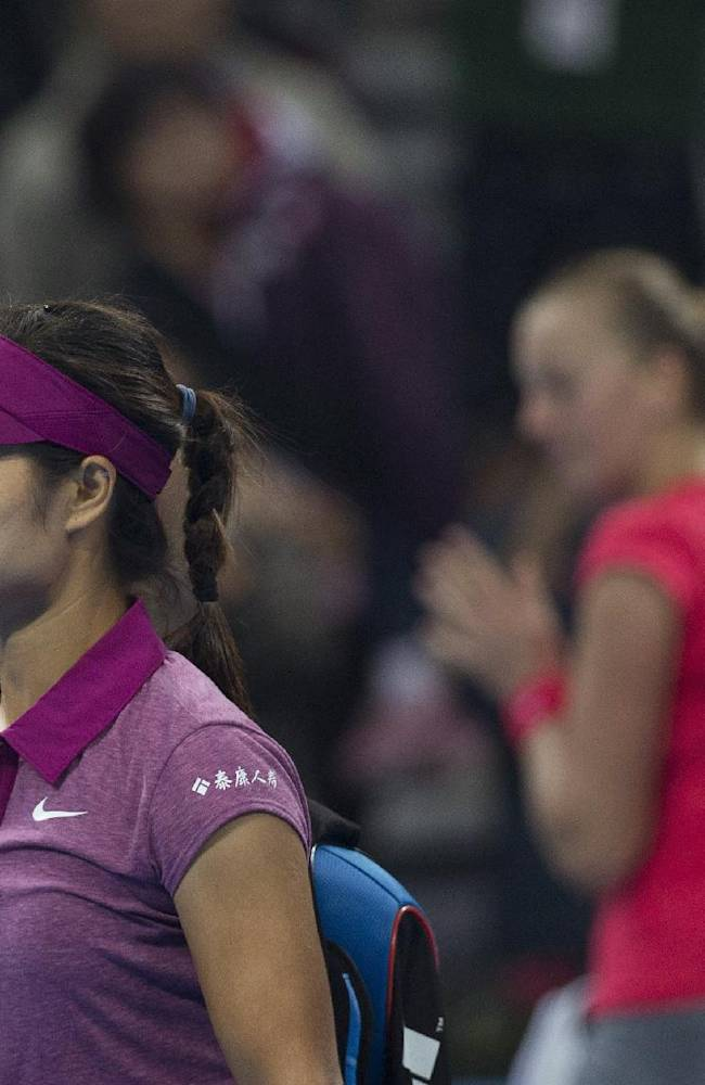 Li Na of China, left, walks past Petra Kvitova of the Czech Republic as she leaves the court after being defeated by Kvitova during the quarterfinal match in China Open tennis tournament at the National Tennis Stadium in Beijing, China Friday, Oct. 4, 2013