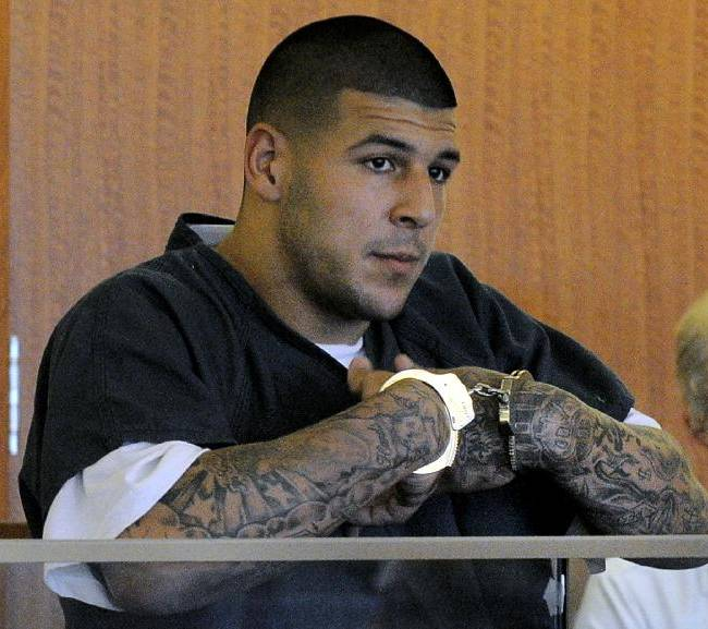 In this June 27, 2013, file photo, former New England Patriots NFL football tight end Aaron Hernandez stands during a bail hearing in Fall River Superior Court in Fall River, Mass. The legal problems of current and former SEC players _ from ex-Florida and NFL tight end Aaron Hernandez to LSU's Jeremy Hill _ has cast a negative light on the league that has won seven consecutive national championships. Coaches in the conference say they have to weigh a player's talent vs. trouble in or out of the locker room