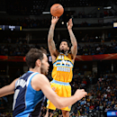 Wilson Chandler #21 of the Denver Nuggets shoots against the Dallas Mavericks on March 5, 2014 at the Pepsi Center in Denver, Colorado. (Photo by Garrett W. Ellwood/NBAE via Getty Images)
