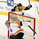 Nashville Predators forward Mike Fisher (12) celebrates after teammate Colin Wilson, not shown, scored against Philadelphia Flyers goalie Steve Mason (35) in the third period of an NHL hockey game Saturday, Nov. 30, 2013, in Nashville, Tenn The Associated