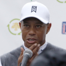 Tiger Woods talks to the media after finishing the second round of the Phoenix Open golf tournament, Friday, Jan. 30, 2015, in Scottsdale, Ariz. (AP Photo/Rick Scuteri)