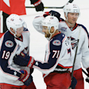 Columbus Blue Jackets' Nick Foligno (71)celebrates a goal with teammates Ryan Johansen (19) and Scott Hartnell (43)against the Ottawa Senators during second period NHL hockey action in Ottawa, Ontario, on Saturday, Oct. 18, 2014 The Associated Press