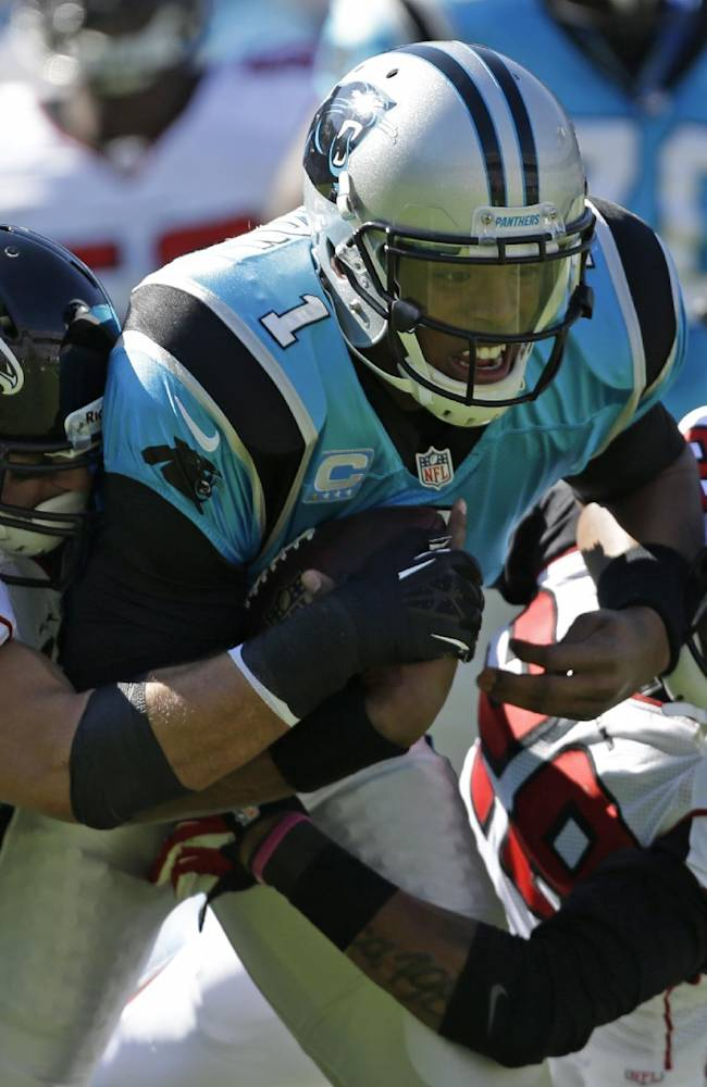Carolina Panthers' Cam Newton (1) is sacked by Atlanta Falcons' Paul Worrilow (55) and Thomas DeCoud (28) in the first half of an NFL football game in Charlotte, N.C., Sunday, Nov. 3, 2013