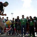 Abel Espinoza, of Atlantic City, N.J., juggles a soccer ball during a competition for prizes before an international soccer friendly match between Mexico and Ivory Coast, Wednesday, Aug. 14, 2013, in East Rutherford, N.J. (AP Photo/Julio Cortez)