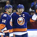 New York Islanders center John Tavares (91) celebrates his goal with left wing Josh Bailey, left, during the second period of an NHL hockey game against the Boston Bruins at Nassau Coliseum on Thursday, Jan. 29, 2015, in Uniondale, N.Y. (AP Photo/Kathy Kmonicek)