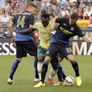 IMAGE DISTRIBUTED FOR GUINNESS INTERNATIONAL CHAMPIONS CUP - AC Milan's Michael Essien (15) battles for the ball with Manchester City's Javi Garcia (14), Matija Nastasic (33) and Jack Rodwell (17) is seen during Guinness International Champions Cup game a