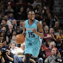 CLEVELAND, OH - JANUARY 23: Kemba Walker #15 of the Charlotte Hornets drives against the Cleveland Cavaliers at The Quicken Loans Arena on January 23, 2015 in Cleveland, Ohio. (Photo by David Liam Kyle/NBAE via Getty Images)