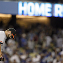 San Francisco Giants relief pitcher David Huff looks down after giving up a solo home run to Los Angeles Dodgers' Hanley Ramirez in the eighth inning of a baseball game Sunday, April 6, 2014, in Los Angeles. The Dodgers won 6-2 The Associated Press