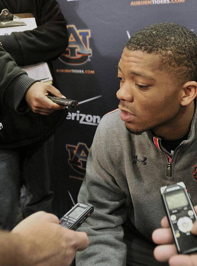 Auburn football quarterback Nick Marshall (14) talks to tmembers of the media on Wednesday, Dec. 18, 2013, in Auburn, Ala