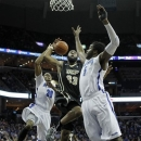 Central Florida forward Keith Clanton (33) goes to the basket against Memphis defenders D.J. Stephens (30) and Shaq Goodwin (5) in the first half of an NCAA college basketball game on Wednesday, Feb. 13, 2013, in Memphis, Tenn. (AP Photo/Lance Murphey)