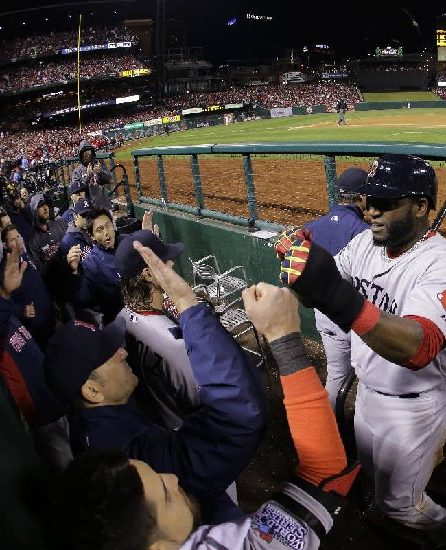 Boston Red Sox designated hitter David Ortiz, right, is congratulated by his teammates after scoring on a sacrifice fly by Stephen Drew during the fifth inning of Game 4 of baseball's World Series against the St. Louis Cardinals Sunday, Oct. 27, 2013, in St. Louis