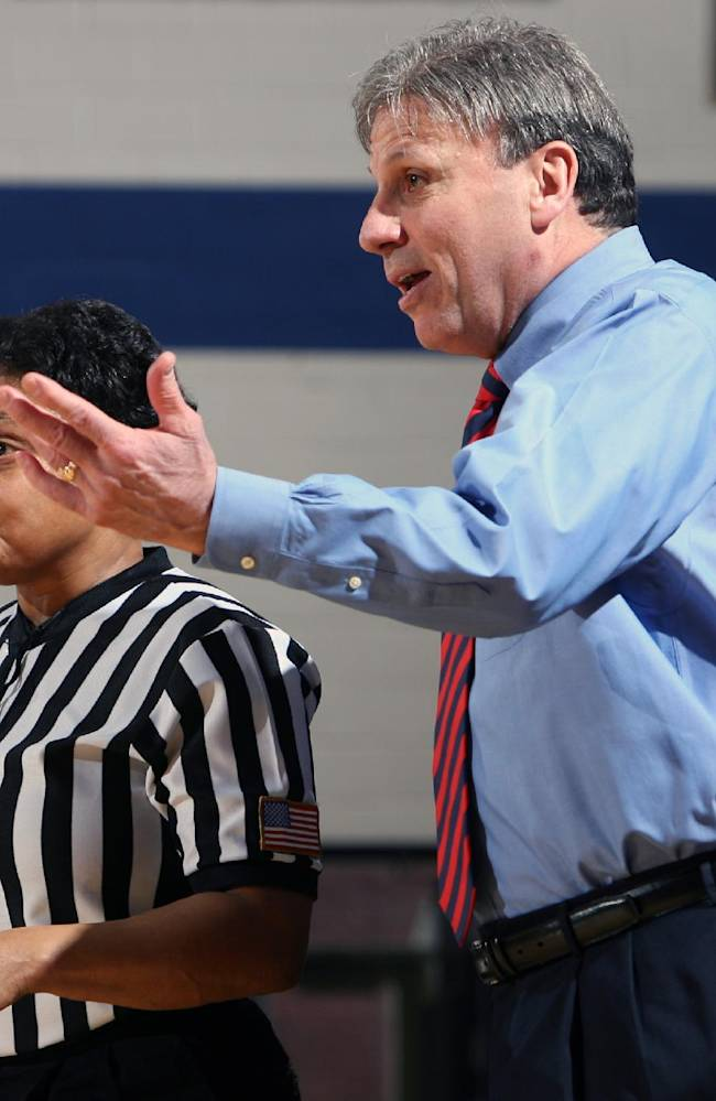 DePaul coach Doug Bruno, right, questions a call with official Bonita Spence during the second half of a NCAA women's basketball game against Notre Dame in Chicago on Sunday, Feb. 24,  2008.  Notre Dame beat DePaul, 66-64