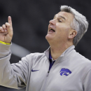 Kansas State coach Bruce Weber talks to his player during practice for a second-round game in the NCAA men's college basketball tournament in Kansas City, Mo., Thursday, March 21, 2013. Kansas State is scheduled to play La Salle on Friday. (AP Photo/Orlin Wagner)