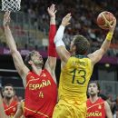 Australia's David Andersen (13) shoots over Spain's Pau Gasol during a men's basketball game at the 2012 Summer Olympics, Tuesday, July 31, 2012, in London. (AP Photo/Charles Krupa)