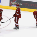 Arizona Coyotes' Sam Gagner (9), Keith Yandle (3) and Brandon McMillan (22) skate off the ice after an NHL hockey game against the Calgary Flames on Thursday, Jan. 15, 2015, in Glendale, Ariz. The Flames defeated the Coyotes 4-1 The Associated Press