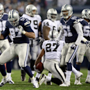 Dallas Cowboys defensive tackle Jason Hatcher (97) celebrates his tackle against Oakland Raiders running back Rashad Jennings (27) during the second half of an NFL football game Thursday, Nov. 28, 2013, in Arlington, Texas The Associated Press