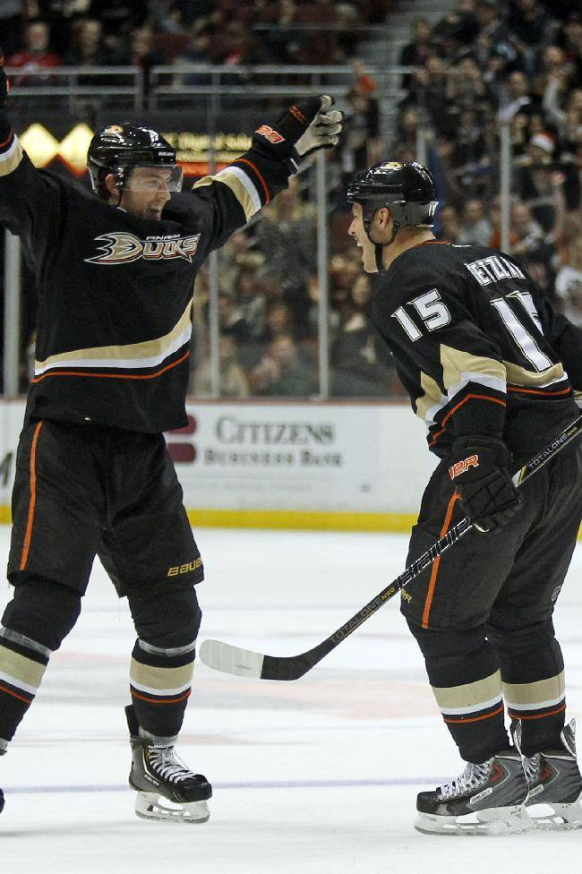Anaheim Ducks defenseman Cam Fowler, left, celebrates a goal by Ducks center Ryan Getzlaf (15) in the second period of an NHL hockey game against New Jersey Devils Wednesday, Nov. 20, 2013, in Anaheim, Calif